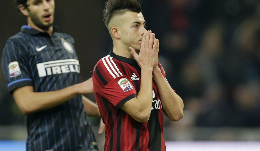 AC Milan's Stephan El Shaarawy reacts after missing a scoring chance during the Serie A soccer match between AC Milan and Inter Milan at the San Siro stadium in Milan, Italy, Sunday, Nov. 23, 2014. (AP Photo/Antonio Calanni)