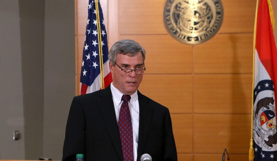 St. Louis County Prosecutor Robert McCulloch announces the grand jury will not indict Ferguson police officer Darren Wilson in the Aug. 9 shooting of Michael Brown. (AP Photo/St. Louis Post-Dispatch, Cristina Fletes-Boutte, Pool)