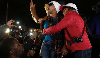 Lesley McSpadden, Michael Brown's mother, is comforted outside the Ferguson police department as St. Louis County Prosecutor Robert McCulloch conveys the grand jury's decision not to indict Ferguson Police Officer Darren Wilson in the shooting death of her son, Monday, Nov. 24, 2014, in Ferguson, Mo. (AP Photo/The St. Louis Post-Dispatch, Robert Cohen) ** FILE **