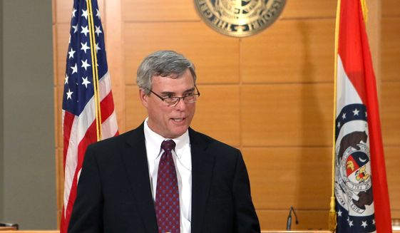 St. Louis County prosecutor Robert McCulloch announces the grand jury's decision not to indict Ferguson police officer Darren Wilson in the Aug. 9 shooting of Michael Brown, an unarmed black 18-year old, on Monday, Nov. 24. (AP Photo/St. Louis Post-Dispatch, Cristina Fletes-Boutte, Pool)