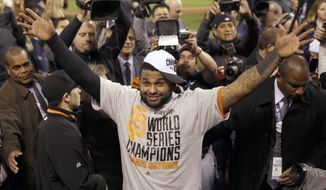 "FILE - In this Oct. 29, 2014, file photo,  San Francisco Giants' Pablo Sandoval celebrates after Game 7 of baseball's World Series against the Kansas City Royals in Kansas City, Mo. The Giants won 3-2 to win the series. Giants assistant general manager Bobby Evans says he has been given ""every indication"" the free agent third baseman will give careful consideration to re-signing with the World Series champions. (AP Photo/Matt Slocum)"