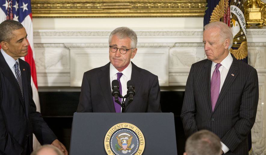 Defense Secretary Chuck Hagel (center) with President Obama (left) and Vice President Joseph R. Biden in the State Dining Room of the White House in Washington, Monday. Mr. Hagel is stepping down under pressure from Obama's Cabinet, senior administration officials said Monday, following a tenure in which he has struggled to break through the White House's insular foreign policy team. (AP Photo/Pablo Martinez Monsivais)