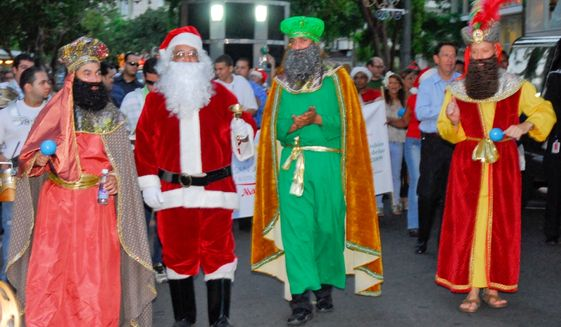 Actors dressed as Santa Claus and the Three Kings walk during a parranda in Puerto Rico. Image courtesy San Juan Marriott.