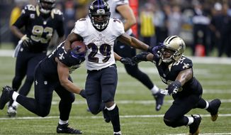 Baltimore Ravens running back Justin Forsett (29) carries on a touchdown run past New Orleans Saints middle linebacker Curtis Lofton (50) in the first half of an NFL football game in New Orleans, Monday, Nov. 24, 2014. (AP Photo/Rogelio Solis)