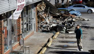 Shan Zhao, owner of On On Cop Suey restaurant, looks at his business while cleaning up Tuesday, Nov. 25, 2014, in Ferguson, Mo. after it was damaged in overnight protests following a grand jury's decision not to indict a white police officer in the killing of unarmed black 18-year-old Michael Brown. (Associated Press)
