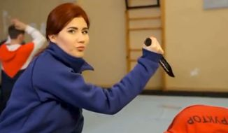 Former Russia spy Anna Chapman demonstrates close-quarters combat in a propaganda video. (Image: YouTube, Anna Chapman)