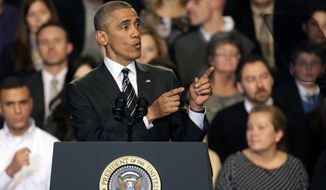 President Obama tries to quiet hecklers as he addresses the crowd after meeting with community leaders about his executive actions on amnesty Tuesday, Nov. 25, 2014, in Chicago. (AP Photo/Charles Rex Arbogast)