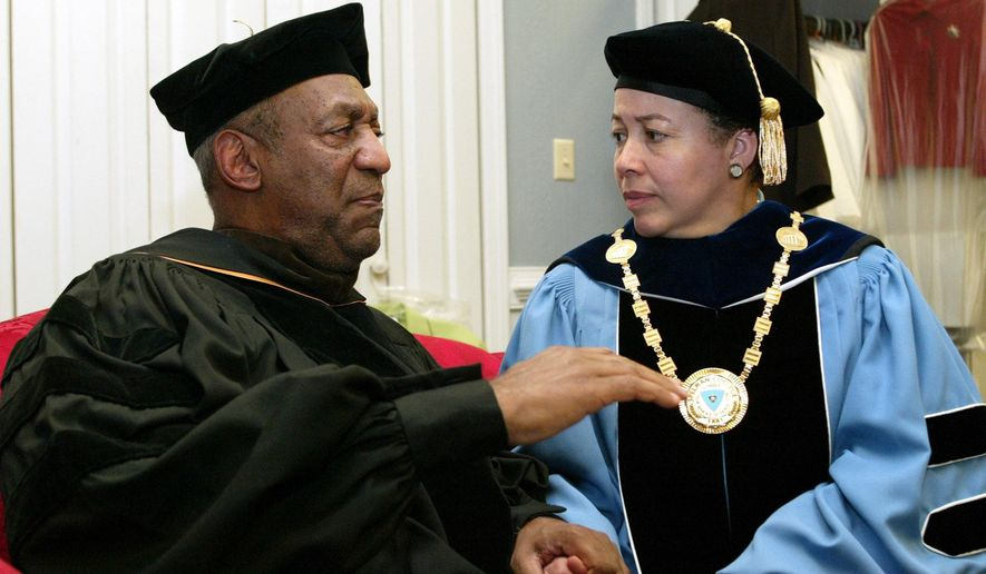 In this May 14, 2006, file photo, keynote speaker Bill Cosby, left, and Spelman College President Dr. Beverly Tatum talk before the start of commencement at the school in Atlanta. (AP Photo/W.A. Harewood, File)