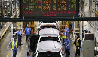 In this Nov. 11, 2014, photo, 2015 Ford F-150s move along the production line at the Dearborn Truck Plant in Dearborn, Mich. The Commerce Department releases third-quarter gross domestic product on Tuesday, Nov. 25, 2014. (AP Photo/Paul Sancya)