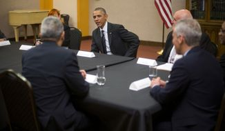 President Barack Obama meets with community leaders at the Copernicus Community Center in Chicago to discuss immigration reform, Tuesday, Nov. 25, 2014. Obama visited his hometown to promote his executive action on immigration. (AP Photo/Pablo Martinez Monsivais)
