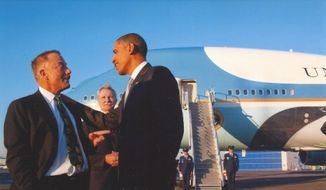 Terrence Patrick Bean, 66, a prominent gay-rights activist and Democratic donor, talks with President Obama with Air Force One in July 2010. (PQ Monthly)