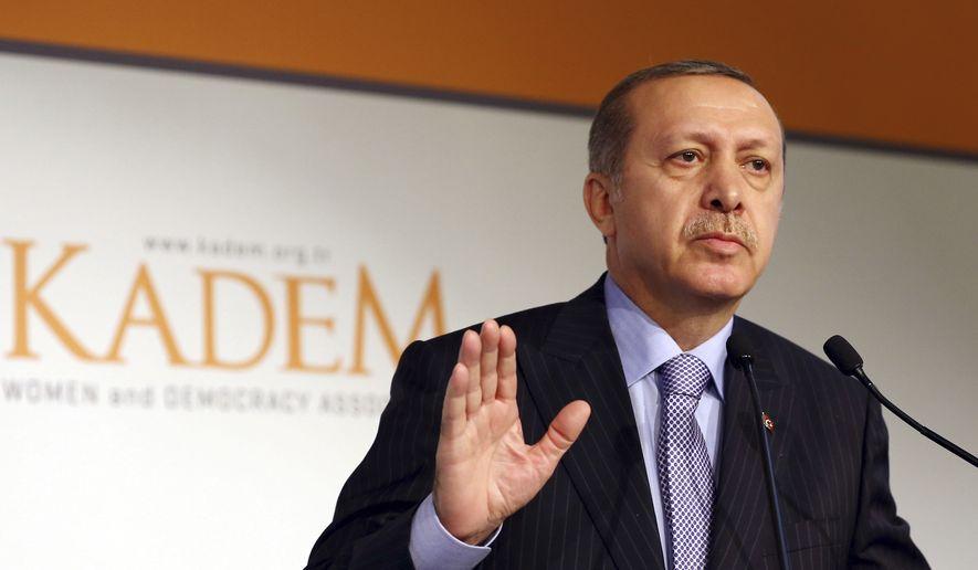 Turkish President Recep Tayyip Erdogan addresses women in Istanbul, Turkey in this Monday, Nov. 24, 2014, photo. (AP Photo) ** FILE **