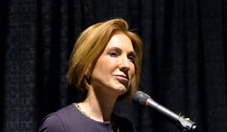 Carly Fiorina, former Chief Executive Officer of Hewlett-Packard, speaks to the Restore America rally in Louisville, Kentucky, Wednesday. Her visits to early caucus and primary states has left an impression that she's testing the waters for a potential dark-horse candidacy for the 2016 Republican presidential race. (Associated Press)