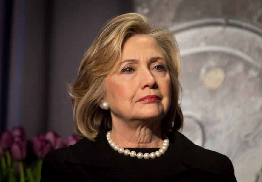 Former Secretary of State Hillary Clinton listens before delivering keynote remarks at the Global Alliance for Clean Cookstoves summit, Friday Nov. 21, 2014, in New York. (AP Photo/Bebeto Matthews)