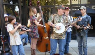 A main street jam session at Bristol, Virginia Rhythm and Roots Reunion. Every September, the Bristol Rhythm and Roots Reunion brings together string talent from around the country for three days in downtown Bristol. (Corinna Lothar/ Special to the Washington Times)