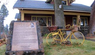 This Nov. 21, 2014 photo shows the sign outside the home where Sonora Smart Dodd lived in Spokane, Washington, in the early 20th century. The sign commemorates Dodd as the person who conceived the idea of Father's Day in 1909, the so-called ``Mother of Father's Day.'' The Craftsman-style house is privately owned and occupied, but the marker telling the story of the local connection to the holiday's history can be seen in the front yard. (AP Photo/Nicholas K. Geranios)