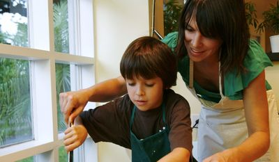 Mimi Chacin helps her son Diego, 9, place home made pizzas onto a tray while cooking dinner at her home in Miami Shores, Fla., Monday, Dec. 1, 2008. (AP Photo/Lynne Sladky) **FILE**