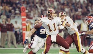 Washington Redskins quarterback Mark Rypien winds up and gets ready to release a pass during first quarter action at the Super Bowl in Minneapolis, on Sunday, Jan. 26, 1992. (AP Photo/Doug Mills) **FILE**