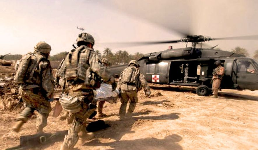 Soldiers rush a trauma victim to a U.S. Army medical helicopter in Tarmiyah, Iraq, Sept. 30, 2007. (U.S. Army)  ** FILE **