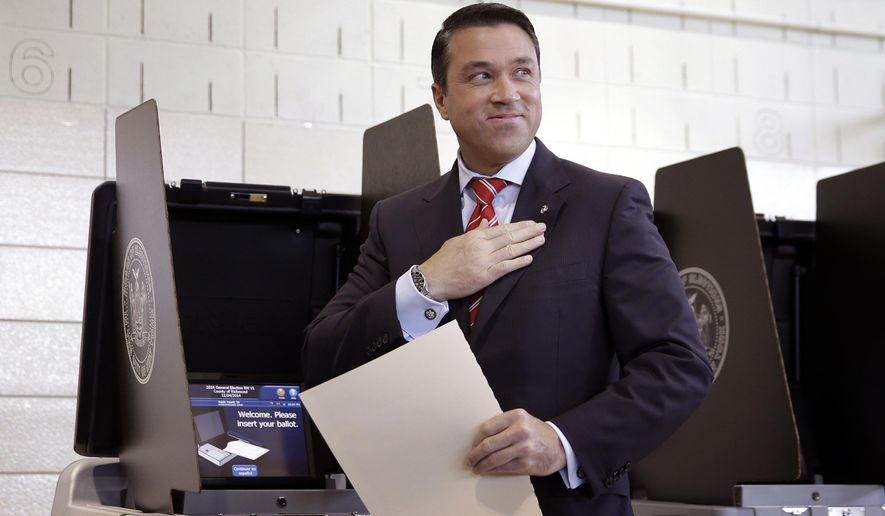 This Nov. 4, 2014, file photo shows Rep. Michael Grimm, R-N.Y., after voting in the borough of Staten Island in New York. Grimm won re-election this month, but he still faces a criminal investigation into possible campaign finance violations, as well as a 20-count indictment on tax fraud and other charges. (AP Photo/Seth Wenig, File)