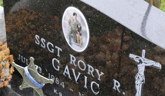 In this Nov. 7, 2014 photo, the grave of Rory Gavic is displayed at St. Francis Catholic Cemetery near Buffalo, Minn. Gavic was a young, decorated military member who served his country overseas twice, who had earned praise and the respect of his peers, who had volunteered as a Big Brother. His suicide in 2009 devastated his family, especially his mother Linda Sawatzke who killed herself four years later with the same handgun. (AP Photo/The St. Cloud Times, Dave Schwarz) ** FILE **