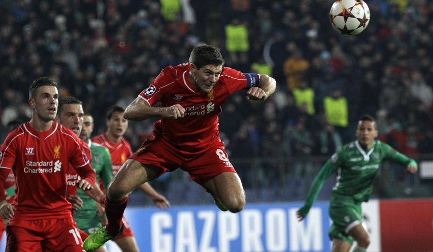 Liverpool's Steven Gerrard, centre, jumps for ball during the Champions League Group B soccer match between Ludogorets and Liverpool at Vassil Levski stadium in Sofia, Bulgaria, Wednesday, Nov. 26, 2014. (AP Photo/Darko Vojinovic)