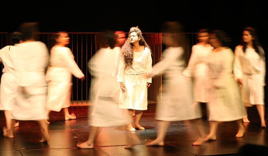 """Inmates from El Buen Pastor women's prison perform the Greek tragedy """"Antigone"""" during the second annual Inmate Theater Festival at a theater in Bogota, Colombia, Tuesday, Nov. 25, 2014.  (AP Photo/Fernando Vergara)"""