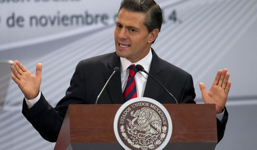 Mexican President Enrique Pena Nieto has vowed to work with U.S. President Barack Obama on immigration issues.  (AP Photo/Rebecca Blackwell)