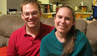 Alyssa Riggan, who was the first in the United States to successfully receive a liver from a living donor 25 years ago, poses with her husband, Benjamin, in their home in Severn, Md., in this Tuesday, Nov. 25, 2014, file photo. (AP Photo/ Brian Witte)