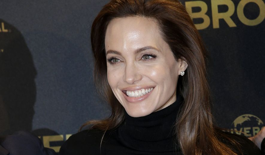 US director Angelina Jolie poses for photographers during a photo call for the movie 'Unbroken' in Berlin, Germany, Thursday, Nov. 27, 2014. (AP Photo/Michael Sohn)
