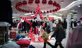 Shoppers search for Black Friday deals during Macy's Lenox store opening at 6 p.m. on Thursday, Nov. 27, 2014 in Atlanta. (John Amis/AP Images for Macy's)