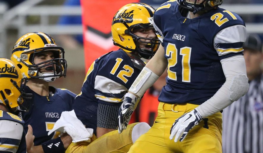 Ithaca high schools Spence DeMull celebrates his touchdown with Tyler Spitzley during the first half against Monroe St. Mary Catholic Central in the Division 6 State Championship game on Friday, Nov, 28, 2014, in Detroit. (AP Photo/Detroit Free Press, Kirthmon F. Dozier)