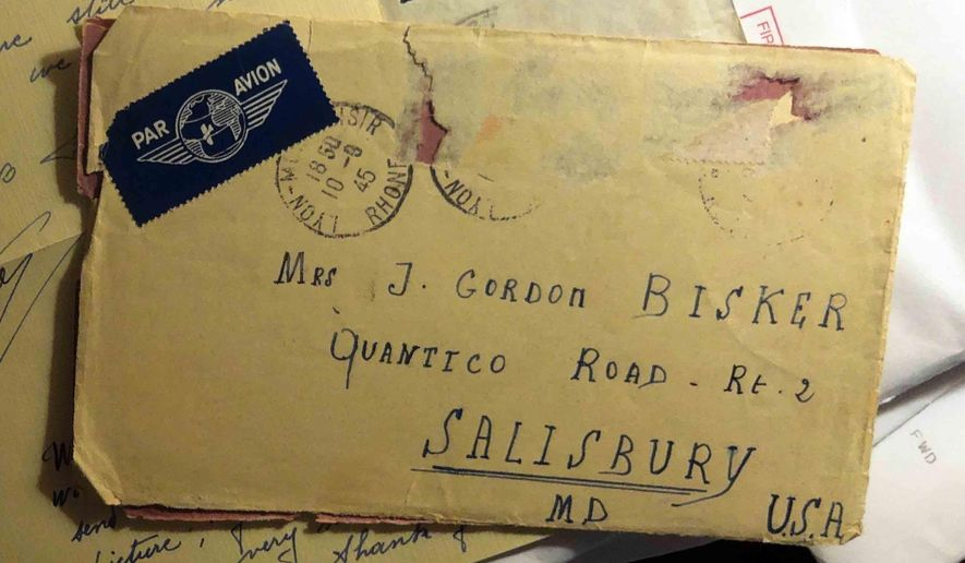This undated photo shows old letters mailed by French girls to Gordon and Clara Bisker of Salisbury, Md. Gordon Bisker had met the young women during World War II, and his son recently tracked down news about what happened to them. (AP Photo/Salisbury Daily Times, Brice Stump)