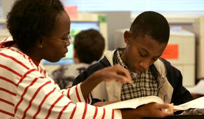 Denise Armstrong, helping son Joseph with schoolwork in this 2005 photo, opted to homeschool her children, feeling she could do better than the public schools at instilling her values in them. (AP Photo/Steve Helber)