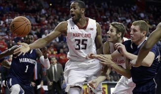 Maryland forward Damonte Dodd (35), guard/forward Jake Layman, second from right, and Monmouth guard Andrew Nicholas, right, chase after a loose ball in the second half of an NCAA college basketball game, Friday, Nov. 28, 2014, in College Park, Md. (AP Photo/Patrick Semansky)