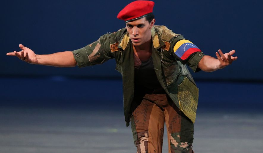 "John Lobo, 29, performing as Venezuela's late president Hugo Chavez, performs in the star role of the ""Ballet of the Spider-Seller to Liberator"" at the Teresa Carreno Theater in Caracas, Venezuela, Thursday, Nov. 27, 2014. (AP Photo/Ariana Cubillos)"
