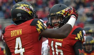Maryland quarterback C.J. Brown (16) celebrates his touchdown with Wes Brown (4) during the first half of an NCAA college football game against Rutgers, Saturday, Nov. 29, 2014, in College Park, Md. (AP Photo/Nick Wass)