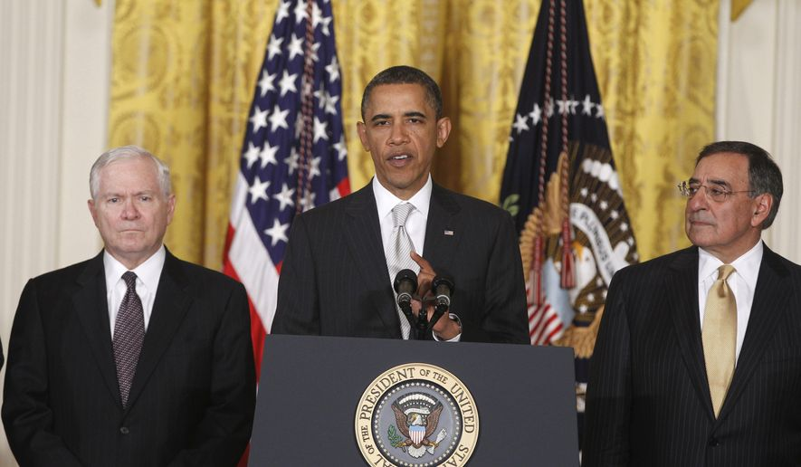 This April 28, 2011, file photo shows President Barack Obama with then-outgoing Defense Secretary Robert Gates, left, and then-Defense Secretary-nominee Leon Panetta, in the East Room of the White House in Washington. (AP Photo/Charles Dharapak, File)