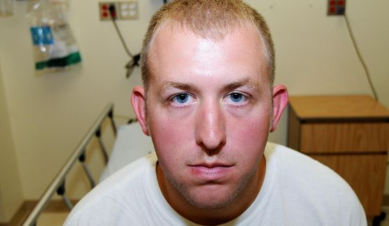 This undated file photo released by the St. Louis County Prosecuting Attorney's office on Monday, Nov. 24, 2014, shows Ferguson Police Officer Darren Wilson during his medical examination after he fatally shot Michael Brown,in Ferguson, Mo.The white police officer who killed Michael Brown has resigned from the Ferguson Police Department, nearly four months after the confrontation that fueled protests in the St. Louis suburb and across the U.S. (AP Photo/St. Louis County Prosecuting Attorney's Office, File)