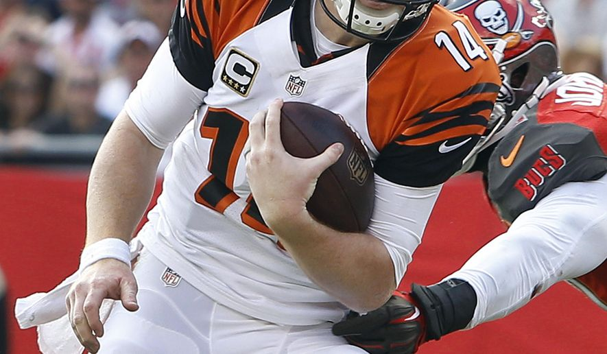 Cincinnati Bengals quarterback Andy Dalton (14) outruns Tampa Bay Buccaneers defensive end Michael Johnson (90) for a 5-yard touchdown run during the second quarter of an NFL football game Sunday, Nov. 30, 2014, in Tampa, Fla. (AP Photo/Brian Blanco)