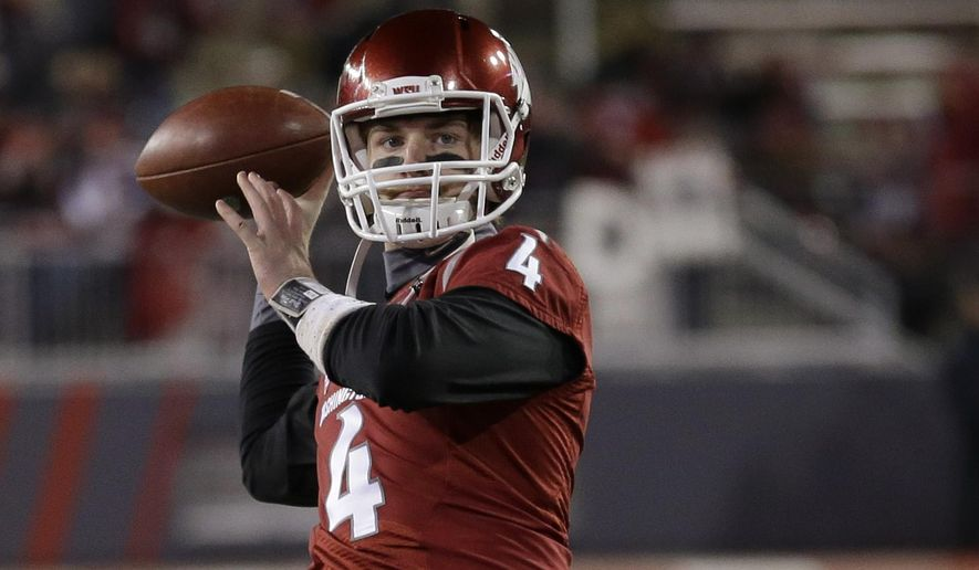 Washington State quarterback Luke Falk passes during warmups before an NCAA college football game against Washington, Saturday, Nov. 29, 2014, in Pullman, Wash. (AP Photo/Ted S. Warren)