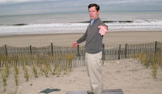 In this Nov. 25, 2014 photo, Thacher Brown stands at the edge of the dune behind his Bay Head, N.J. home. Brown is one of a group of oceanfront homeowners spending $5 million to install their own sand-covered rock wall to protect Bay Head from future storms, and who oppose Gov. Chris Christie's plan to widen beaches and build dunes along the state's entire 127-mile coastline. Among oceanfront homeowners opposed to the plan is Lawrence Bathgate, a major Republican national fundraiser whose help Christie will surely seek if he runs for president in 2016. (AP Photo/Wayne Parry)