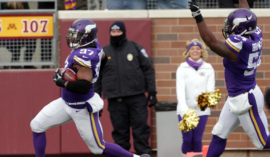 Minnesota Vikings defensive end Everson Griffen, left, celebrates with teammate Jasper Brinkley as he returns a blocked punt for a touchdown during the first half of an NFL football game against the Carolina Panthers, Sunday, Nov. 30, 2014, in Minneapolis. (AP Photo/Jim Mone)