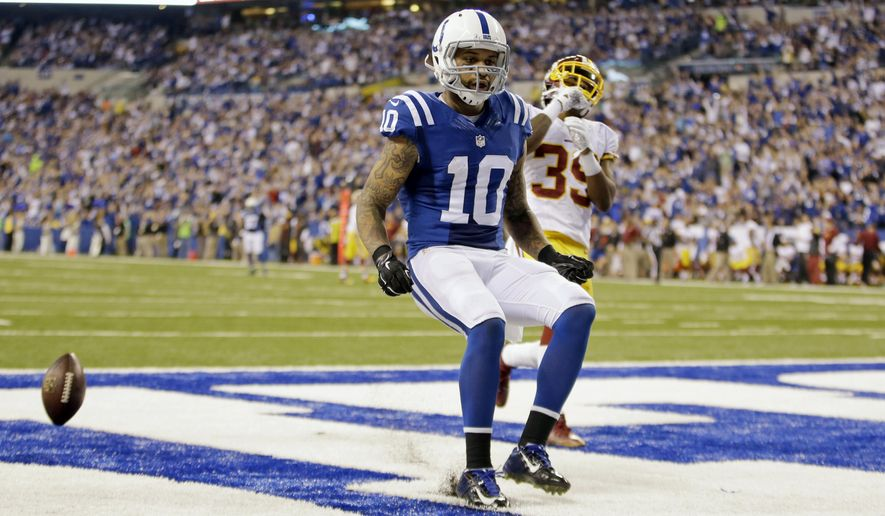 Indianapolis Colts wide receiver Donte Moncrief scores a touchdown on a 48-yard pass from quarterback Andrew Luck in front of Washington Redskins running back Roy Helu during the second half of an NFL football game Sunday, Nov. 30, 2014, in Indianapolis. (AP Photo/AJ Mast)