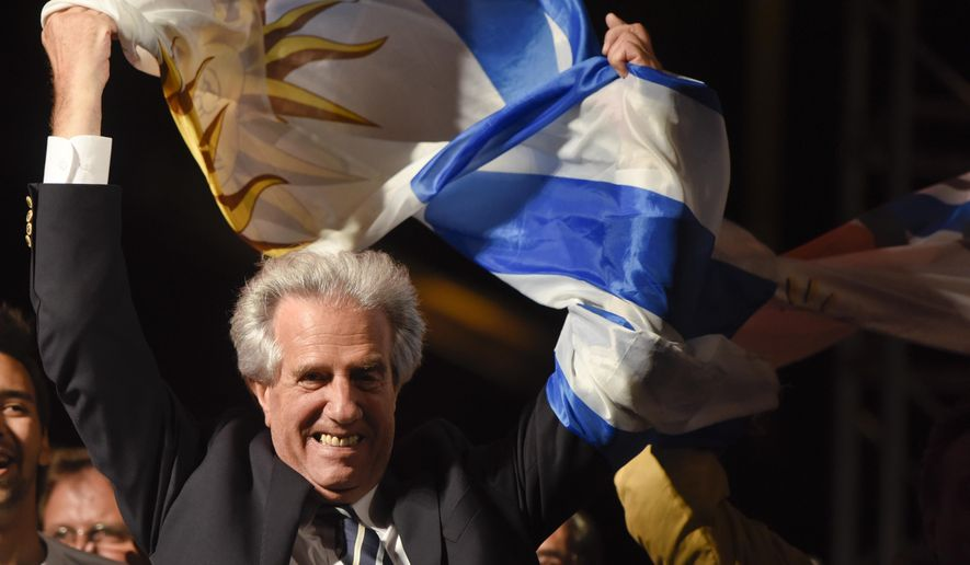 Presidential candidate for the ruling Broad Front party Tabare Vazquez celebrates in Montevideo, Uruguay Sunday, Nov. 30, 2014. Exits polls shows that Broad Front coalition candidate and former president Tabare Vazquez has won the presidential elections.(AP Photo/Matilde Campodonico)