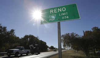 In this Wednesday, Nov. 19, 2014 photo, vehicles drive past the city limits of Reno, Texas. This rural community sits surrounded by hydraulic fracturing drilling operations and is considering passing a municipal ban on fracking within the city limits. (AP Photo/LM Otero)