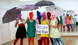 The all-female punk rock band Pussy Riot showed their support for pro-democracy protesters in Hong Kong in the form of a photographic tributes. The umbrella symbolizes the two-month long protests that have swept Hong Kong as citizens call for free leadership elections in 2017. (Facebook/Stand By You 2.0)