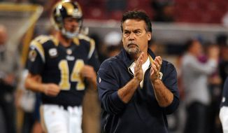 St. Louis Rams head coach Jeff Fisher roams the field before the start of an NFL football game between the St. Louis Rams and the Oakland Raiders Sunday, Nov. 30, 2014, in St. Louis. (AP Photo/L.G. Patterson)