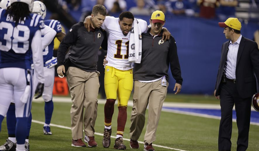 Washington Redskins wide receiver DeSean Jackson is assisted off the field after being injured during the second half of an NFL football game against the Indianapolis Colts Sunday, Nov. 30, 2014, in Indianapolis. (AP Photo/Darron Cummings)