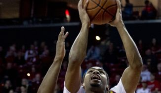 Maryland's Richaud Pack (20), goes to the basket as VMI's QJ Peterson (22) try to block during the second half of an NCAA college basketball game at Xfinity Center in College Park, Md., Sunday, Nov. 30, 2014. (AP Photo/Jose Luis Magana)